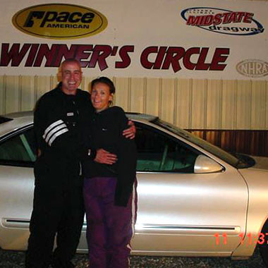 Crew Chief Pro Owners, Don and Mmichelle Higgins, in the winners Circle with help from their drag racing software!